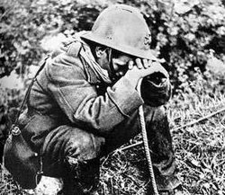 French soldier weeping after the Battle of France, May 1940.