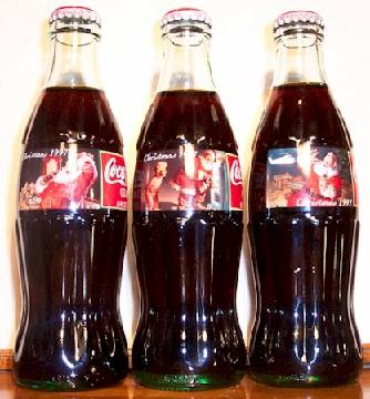 Specially designed Christmas labels featuring Santa Claus on Coca Cola bottles