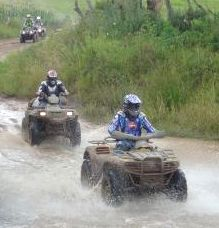 Quad bikes crossing river
