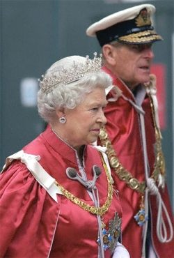Lady in Red, Queen Elizabeth 2004 OBE ceremony with Prince Philip