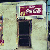 Store or Cafe with Coca Cola Soft Drink Signs - Marion Post Wolcott, photographer