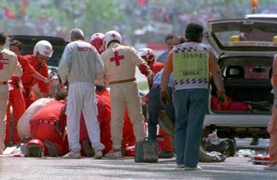 Ayrton Senna is attended to by medics after crashing in the San Marino Grand Prix in 1994