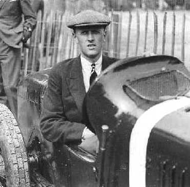 Henry Segrave sitting in his racing car