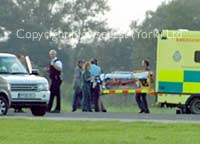 Paramedics prepare to take Richard Hammond to hospital after the crash at Elvington Airfield