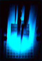 "Cherenkov effect in a ""swimming pool"" nuclear reactor. The effect is due to electrons moving faster than the speed at which light moves in water."